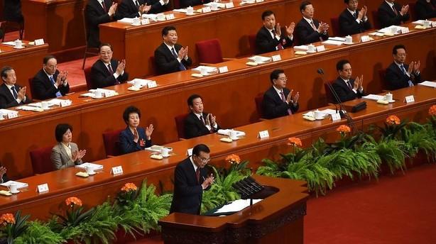 Kina s�nker forventninger til v�ksten i �r