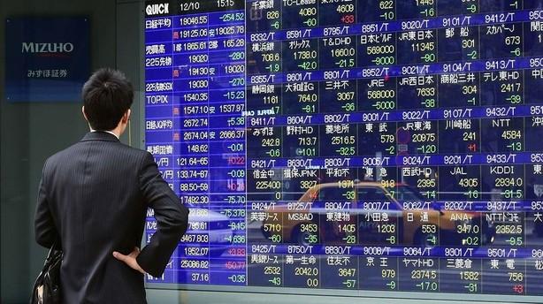 Aktier: Voldsomme udsving i Tokyo efter rentes�nkning