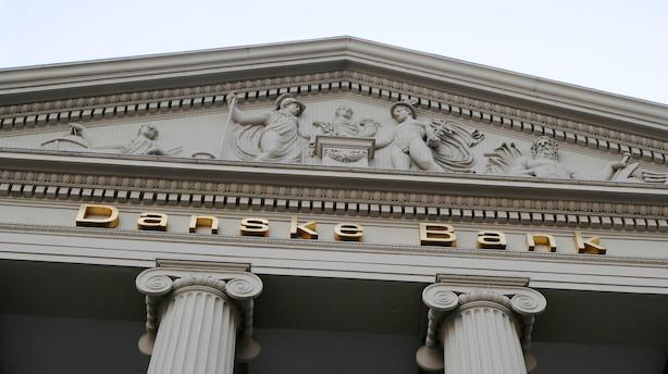 Danske Bank opjusterer forventningerne til årets resultat efter frasalg